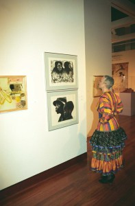 """Camille Olivia Hanks Cosby viewing """"Lovey Twice,"""" 1976, and """"Two Generations,"""" 1979 by Elizabeth Catlett in """"Rediscovery: Works from the Spelman College Collection,"""" 1996."""