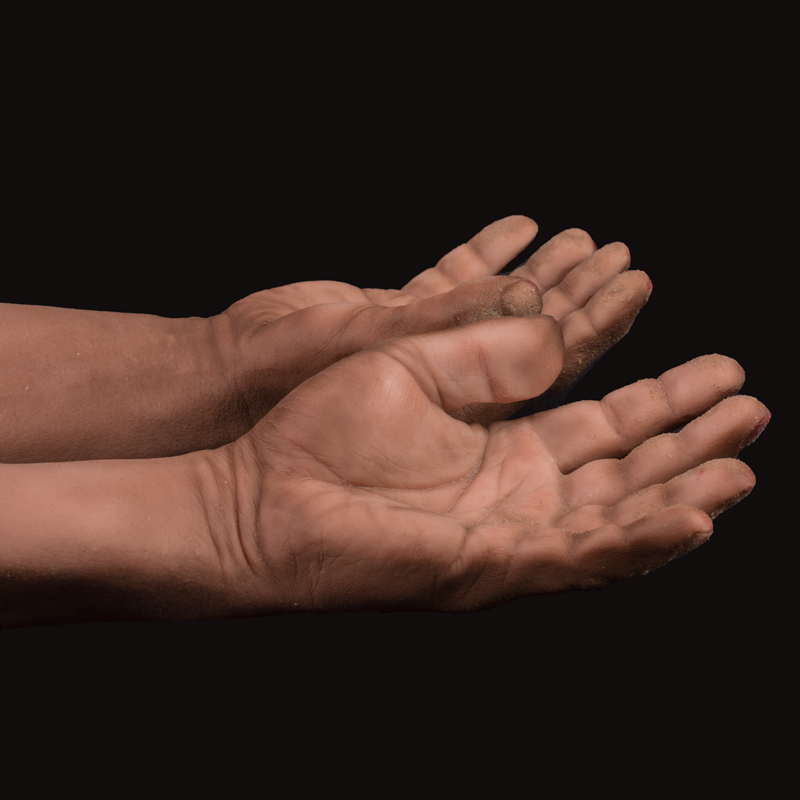 Silicone display hand with sand and blood