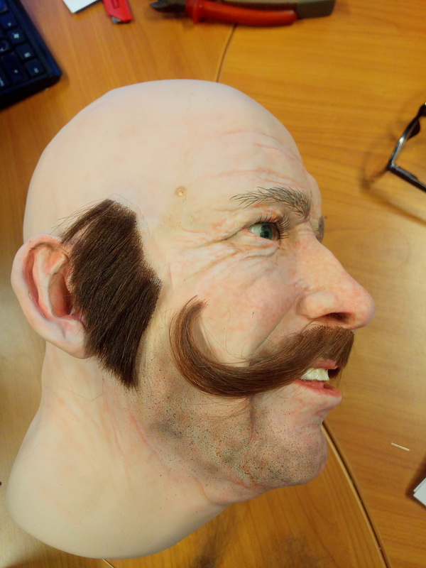 Display mannequin head with handlebar style moustache and sideburns
