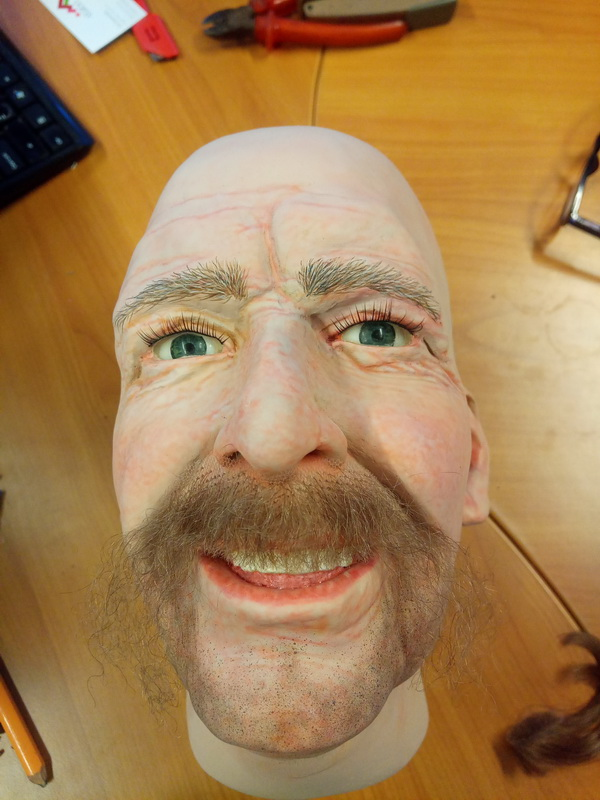 Display mannequin head with blond horshoe style moustache