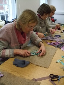 Creatives at work! Participants get busy making rag rugs during a Scrap Values workshop.