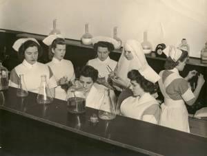 Nurses in training with a Sister at St. Joseph's School of Nursing.  Courtesy of the RHSJ St. Joseph Regional Archives