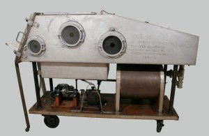 A 1937 Iron Lung from the Museum's collection (#997019003), restored at the Canadian Conservation Institute, is a centre-piece of the exhibition.  This iron lung is one of 28 constructed at Toronto's Hospital for Sick Children during the polio epidemic of 1937.  So many cases were admitted to hospital that an 'emergency' crew of engineers and tradesmen ran an assembly line in the basement of the hospital to construct the iron lungs.  The iron lungs were paid for by the Ontario government and shipped to parts of the province where they were needed during the epidemic.  This one was used in Kingston General Hospital for several decades.