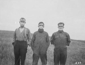Men wearing masks during the Spanish Influenza epidemic, circa 1918.
