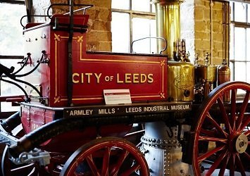 Victorian era steam powered vehicle with 'City of Leeds' printed on the side