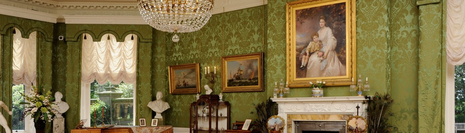 Lotherton drawing room with several paintings, furniture, busts and a fireplace