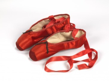 Red ballet shoes made for Victoria Page (Moira Shearer) in The Red Shoes (1948), silk satin, braid and leather, England, 1948, Freed of London (founded in 1929), Photograph reproduced with the kind permission of Northampton Museums and Art Gallery