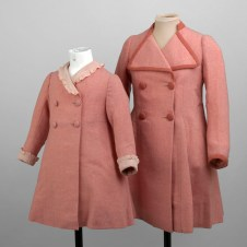 Pink coats worn by Princesses Elizabeth and Margaret for an official visit to the Palace of Holyroodhouse with their parents King George VI and Queen Elizabeth, 1937. 'Fashioning a Reign: 90 Years of Style from The Queen's Wardrobe' at the Palace of Holyroodhouse, 21 April – 16 October 2016. Royal Collection Trust / (c) Her Majesty Queen Elizabeth II 2016.
