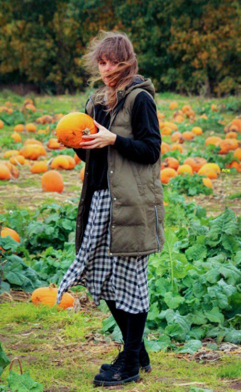 mom on pumpkin field