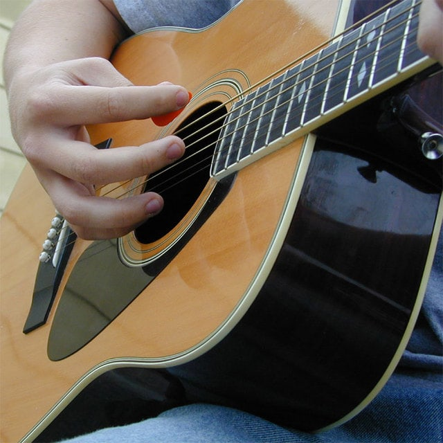 an-acoustic-guitar-1480141-640x640