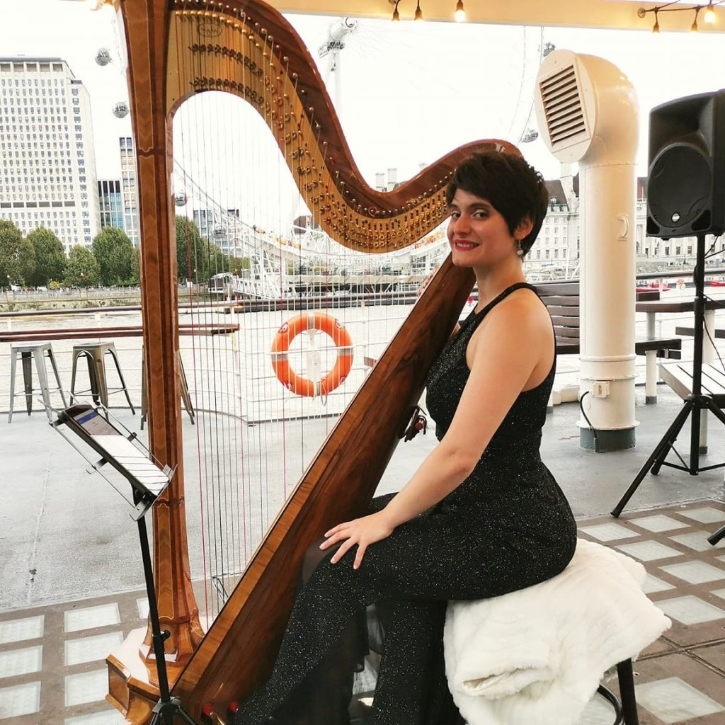 Harpist Performing by the Thames in London