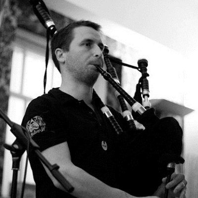 Traditional Bagpiper In London
