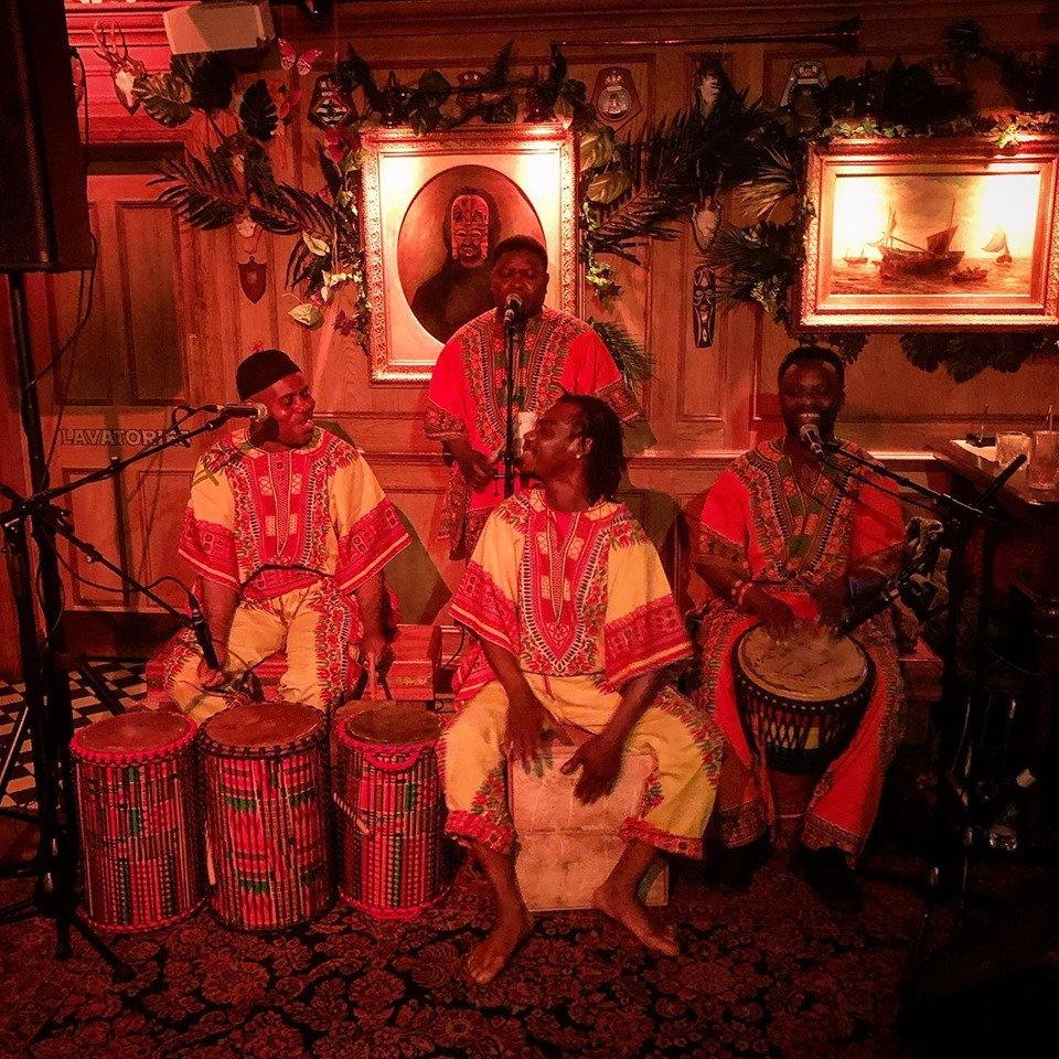 African Entertainers Greeting Guests at a Cultural Event in London.