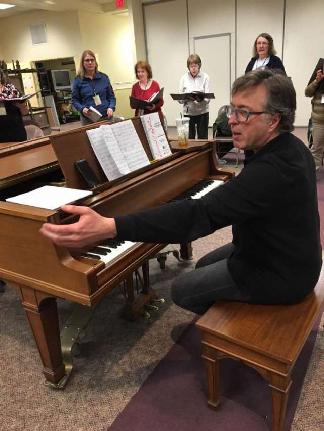 "Eric Dale Knapp, director of the Connecticut Choral Society, leads a rehearsal for the group's ""Bernstein @100"" concert, to be held at Trinity Episcopal Church in Newtown on May 4, and at North Congregational Church in Woodbury on May 5. Photo: Robin Lindenbaum Sills / Contributed Photo"