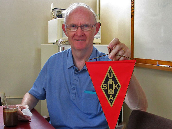 Josef HB9CIC with the Swiss Amateur Radio Society pennant he presented to Musick Point Radio Group