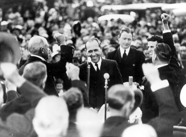Captain Edwin Musick, being greeted on arrival in Auckland, 30 March 1937