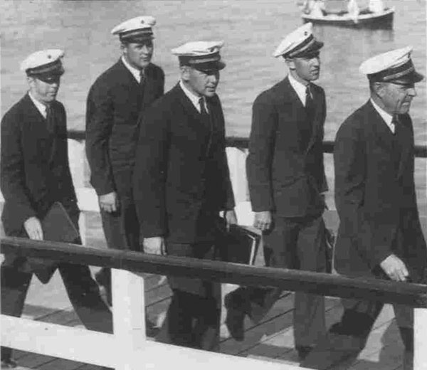 Captain Edwin Musick leaders four of his six officers ashore in Auckland, 26 Dec 1937
