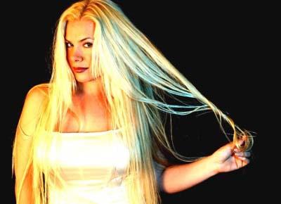 Amanda Somerville with blonde hair promo photo