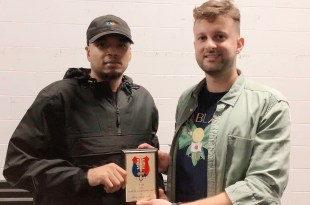 28. Jun President Filip Filipi presents Smitty with the 'Humanitarian of the Year Award' for 2019.