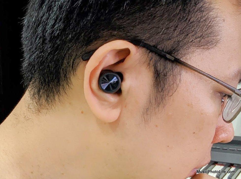 Plantronics BackBeat PRO 5100 earbuds worn on ears