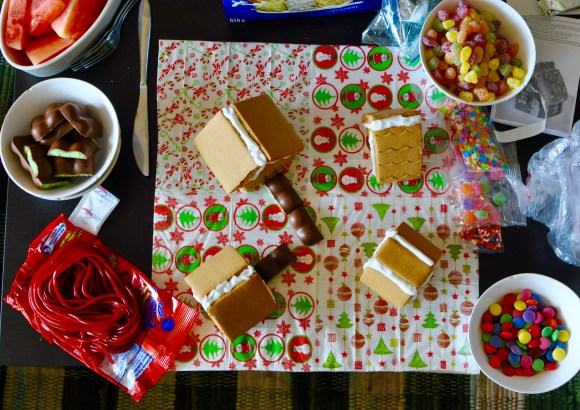 Gingerbread house making supplies on a table from above.