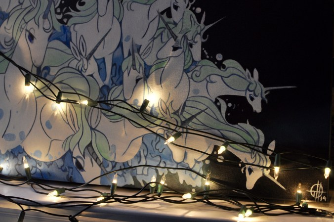 Close up of Christmas lights and the Last Unicorn Painting.