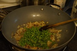 Adding the peas and cilantro