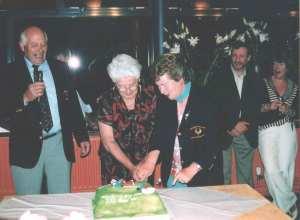 Mary-Gamble-cuts cake
