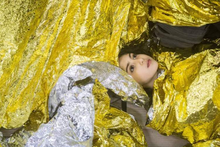 Syrian refugee girl sleeping on an Italian navy ship after being rescued.