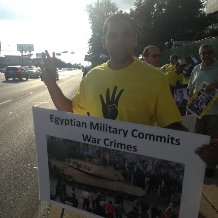 Photo of Mustafa in a pro-Rabaa Rally in the Texas.
