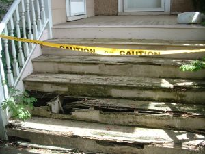 Rotting wooden porch steps