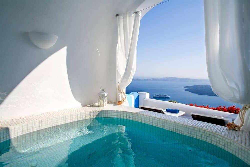 7 stunning hotels in santorini with private pools and. Black Bedroom Furniture Sets. Home Design Ideas