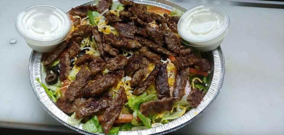 O Town Burgers Halal Food Restaurants in Orlando Florida a gyro dish prepared
