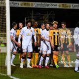 462028306-players-pack-the-six-yard-box-as-cambridge-gettyimages[1]