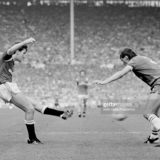 Norman Whiteside (left) shoots past Everton defender Pat Van Den Hauwe to score Manchester United's winning goal in the FA Cup Final at Wembley Stadium, London on 18th May 1985. Manchester United beat Everton 1-0 after extra time. (Photo by Keith Hailey/Popperfoto/Getty Images)