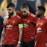 GDANSK, POLAND - MAY 26: (L-R) Bruno Fernandes, Alex Telles and Fred of Manchester United look dejected following the UEFA Europa League Final between Villarreal CF and Manchester United at Gdansk Arena on May 26, 2021 in Gdansk, Poland. (Photo by Kacper Pempel - Pool/Getty Images)