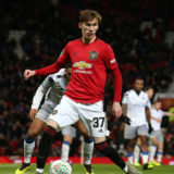 MANCHESTER, ENGLAND - DECEMBER 18:  James Garner of Manchester United in action during the Carabao Cup Quarter Final match between Manchester United and Colchester United at Old Trafford on December 18, 2019 in Manchester, England. (Photo by Matthew Peters/Manchester United via Getty Images)