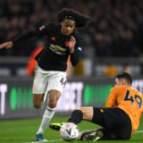 WOLVERHAMPTON, ENGLAND - JANUARY 04: Tahith Chong of Manchester United is tackled by Max Kilman of Wolverhampton Wanderers  during the FA Cup Third Round match between Wolverhampton Wanderers and Manchester United at Molineux on January 04, 2020 in Wolverhampton, England. (Photo by Shaun Botterill/Getty Images)