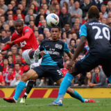 MANCHESTER, ENGLAND - AUGUST 28:  Ashley Young of Manchester United curls the ball and scores his side's second goal during the Barclays Premier League match between Manchester United and Arsenal at Old Trafford on August 28, 2011 in Manchester, England.  (Photo by Alex Livesey/Getty Images)