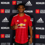 MANCHESTER, ENGLAND - JANUARY 13:  Amad Diallo of Manchester United poses with his team shirt on his first day at Aon Training Complex on January 13, 2021 in Manchester, England. (Photo by Ash Donelon/Manchester United via Getty Images)