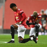 MANCHESTER, ENGLAND - NOVEMBER 01: Marcus Rashford of Manchester United takes a knee in support of the Black Lives Matter movement prior to the Premier League match between Manchester United and Arsenal at Old Trafford on November 01, 2020 in Manchester, England. Sporting stadiums around the UK remain under strict restrictions due to the Coronavirus Pandemic as Government social distancing laws prohibit fans inside venues resulting in games being played behind closed doors. (Photo by Shaun Botterill/Getty Images)