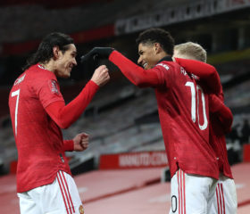 MANCHESTER, ENGLAND - JANUARY 24: Marcus Rashford of Manchester United is congratulated by team mates (L - R) Edinson Cavani and Donny Van De Beek after scoring their side's second goal during The Emirates FA Cup Fourth Round match between Manchester United and Liverpool at Old Trafford on January 24, 2021 in Manchester, England. Sporting stadiums around the UK remain under strict restrictions due to the Coronavirus Pandemic as Government social distancing laws prohibit fans inside venues resulting in games being played behind closed doors. (Photo by Martin Rickett - Pool/Getty Images)