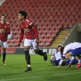 LEIGH, ENGLAND - FEBRUARY 05: Shola Shoretire of Manchester United U23s celebrates scoring their fifth goal during the Premier League 2 match between Manchester United U23s and Blackburn Rovers U23s at Leigh Sports Village on February 05, 2021 in Leigh, England. (Photo by John Peters/Manchester United via Getty Images)