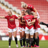 LEIGH, ENGLAND - MAY 09: Ella Toone of Manchester United celebrates with team mates Jackie Groenen, Lucy Staniforth, Katie Zelem, Jane Ross and Millie Turner after scoring her team's first goal during the Barclays FA Women's Super League match between Manchester United Women and Everton Women at Leigh Sports Village on May 09, 2021 in Leigh, England. Sporting stadiums around the UK remain under strict restrictions due to the Coronavirus Pandemic as Government social distancing laws prohibit fans inside venues resulting in games being played behind closed doors. (Photo by Charlotte Tattersall/Getty Images)