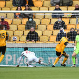 WOLVERHAMPTON, ENGLAND - MAY 23: Anthony Elanga of Manchester United scores the opening goal during the Premier League match between Wolverhampton Wanderers and Manchester United at Molineux on May 23, 2021 in Wolverhampton, England. A limited number of fans will be allowed into Premier League stadiums as Coronavirus restrictions begin to ease in the UK. (Photo by Andy Rain - Pool/Getty Images)