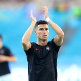 SEVILLE, SPAIN - JUNE 27: Cristiano Ronaldo of Portugal applauds the fans as he warms up prior to the UEFA Euro 2020 Championship Round of 16 match between Belgium and Portugal at Estadio La Cartuja on June 27, 2021 in Seville, Spain. (Photo by Alexander Hassenstein/Getty Images)