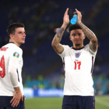 ROME, ITALY - JULY 03: Mason Mount and Jadon Sancho of England acknowledge the fans after victory in the UEFA Euro 2020 Championship Quarter-final match between Ukraine and England at Olimpico Stadium on July 03, 2021 in Rome, Italy. (Photo by Lars Baron/Getty Images)