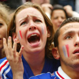PARIS - JUNE 11:  French soccer fans react as their team is defeated by Denmark 2-0 during the 2002 World Cup watched on a giant screen June 11, 2002 in Paris, France.  (Photo by Pascal Le Segretain/Getty Images)
