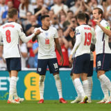 LONDON, ENGLAND - SEPTEMBER 05: Harry Kane of England celebrates with Jordan Henderson, Jesse Lingard and Mason Mount after scoring their team's second goal from the penalty spot during the 2022 FIFA World Cup Qualifier match between England and Andorra at Wembley Stadium on September 05, 2021 in London, England. (Photo by Shaun Botterill/Getty Images)