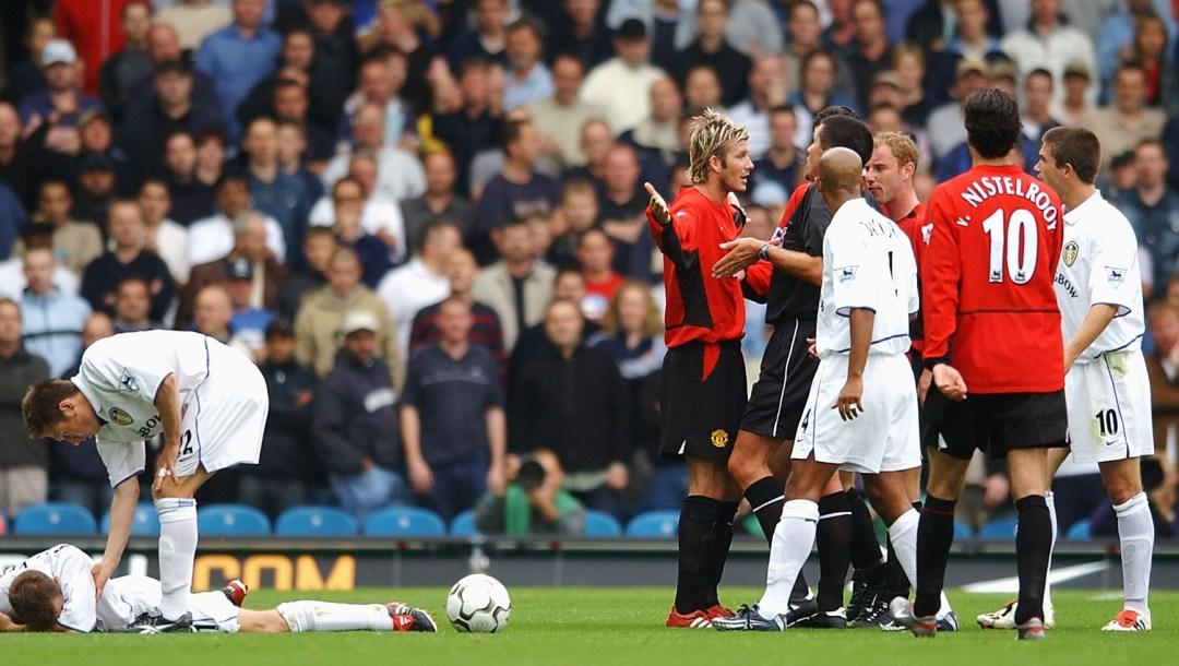 David Beckham of Manchester United tackle